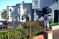Some guy taking photos from the top of Lombard Street.